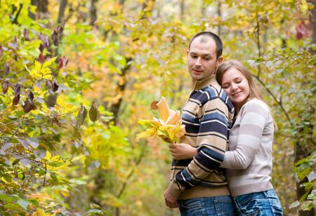happy couple walking in autumn forest Stock Photo - 5706225