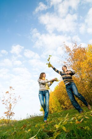 happy couple enjoying the falling leaves Stock Photo - 5706214