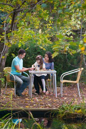 a family relaxing in garden photo