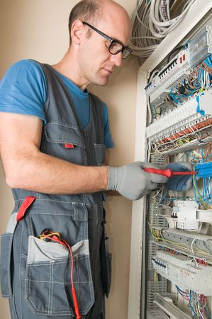 electrician make connections in main electical panel photo
