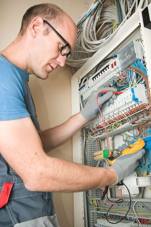 electrician make connections in main electical panel Stock Photo