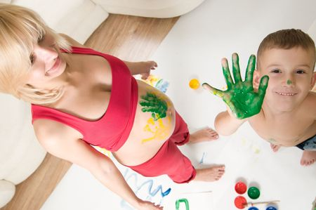 pregnant woman and her son drawing photo