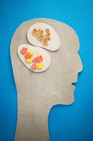 subconsciousness: human head with gears and flowers Stock Photo