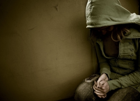 teenage girl siting against wall in a depressed state Stock Photo - 6106651
