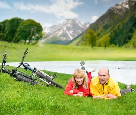 two cyclists on river bank