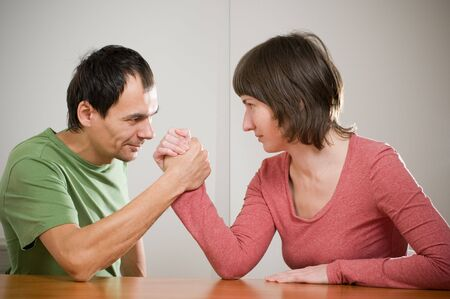 a family comic arm wrestling photo