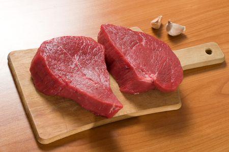 hardboard: two raw meats on hardboard