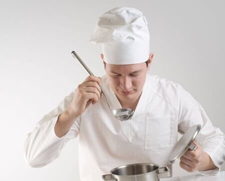 chef with ladle and pan photo