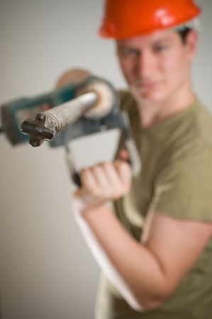 worker with big drill machine photo