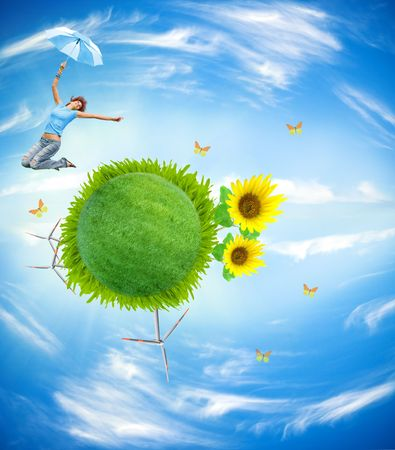 earth globe covered grass with jumping girl Standard-Bild