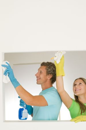 housewife gloves: happy couple cleaning at home