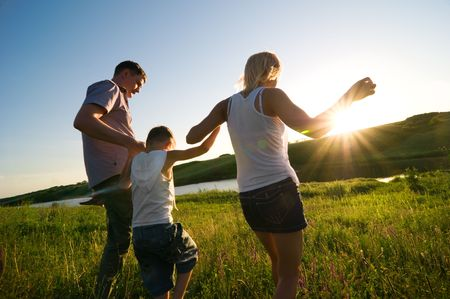having fun: happy family having fun outdoors Stock Photo