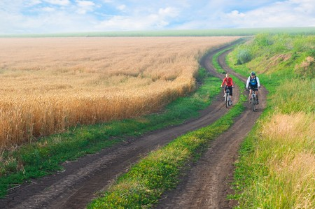 adventure sports: two cyclist relax biking outdoors Stock Photo