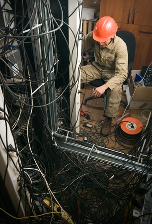 technician working on cables and wires