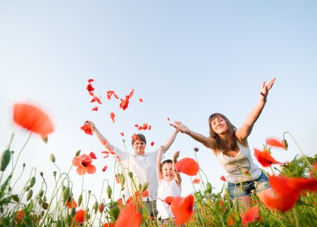family in red poppy field