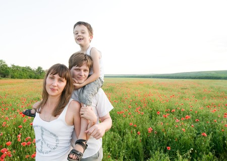 family in red poppy field Stock Photo - 7551974