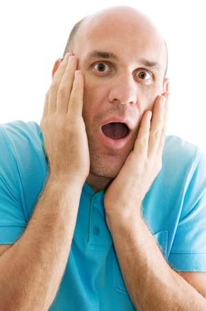 cara sorprendida: hombre sorprendido aislado en blanco  Foto de archivo