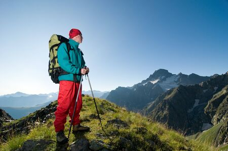 man hiking in mountain with backpack Standard-Bild