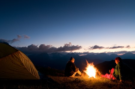 campfires: couple tent camping in the wilderness
