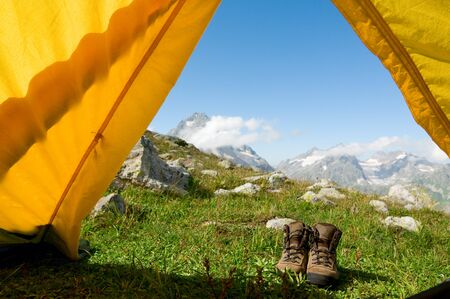 hiking concept shoes and tent Stock Photo - 7785338