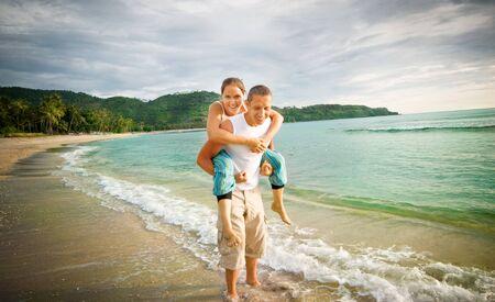 couple having fun at seaside photo