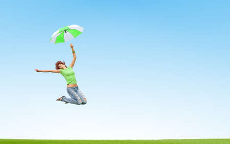 young girl jumping with umbrella photo