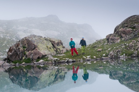 couple hiking in the mountain  photo