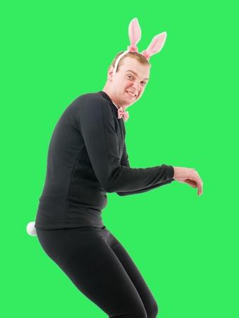 Man in suit wearing rabbit mask Stock Photo
