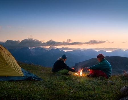camping tent: couple tent camping in the wilderness