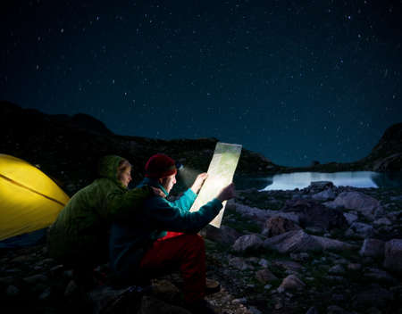 trek: couple tent camping in the wilderness
