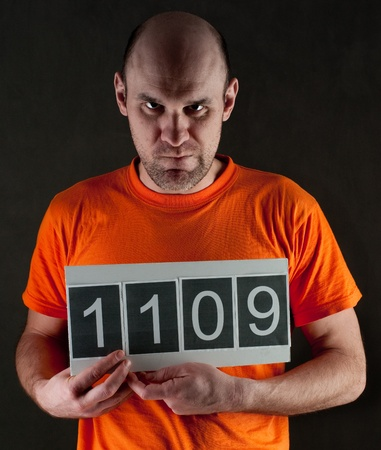 prisoner man: arrested man  wearing a orange jumpsuit Stock Photo