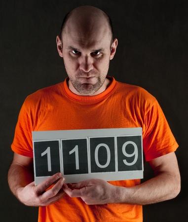 detenuti: uomo arrestato indossava una tuta arancione Archivio Fotografico