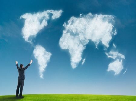 businessman with world map shaped clouds
