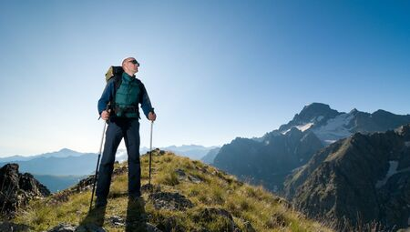 man hiking in a mountain photo