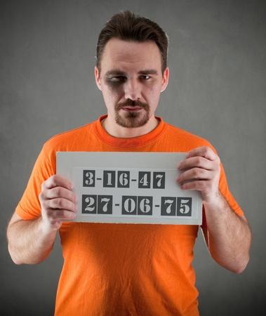 arrested man  wearing a orange jumpsuit Standard-Bild