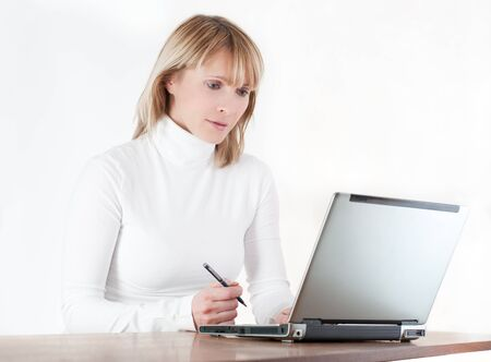 woman working on computer on white background photo