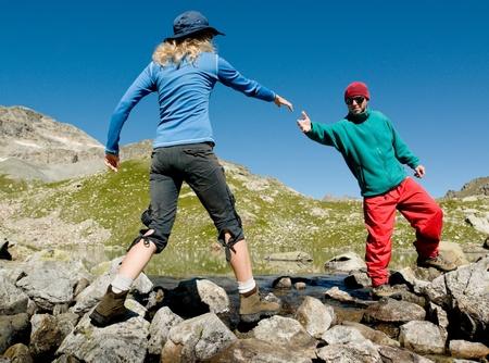 man helping hand to woman Standard-Bild
