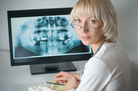 Doctor looking at x-ray on computer Stock Photo
