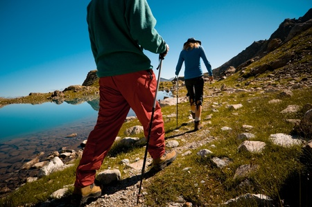 trekking: couple hiking in the mountain  Stock Photo