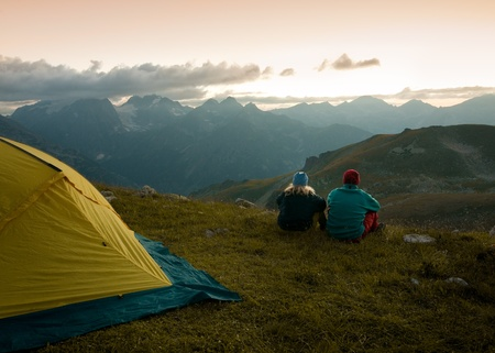couple tent camping in the wilderness