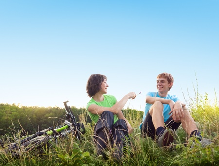 two cyclists relax biking outdoors photo