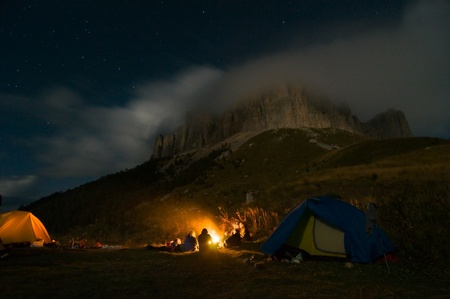bonfire night: people camping in the wilderness