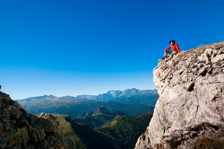 man hiking in a mountain photo
