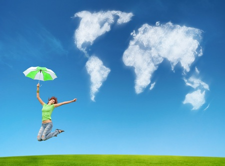 a woman with umbrella on earth background photo