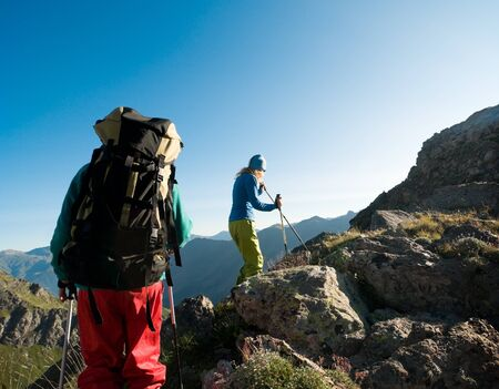 rock climbing man: couple hiking in the mountain  Stock Photo