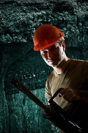 pitman: worker with big drill machine  Stock Photo