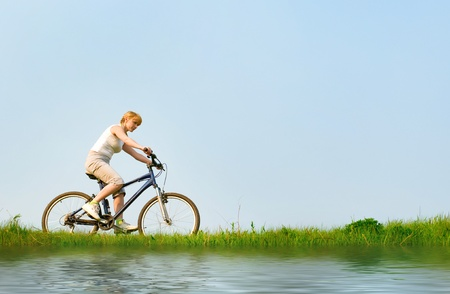 girl relax biking near a lake photo