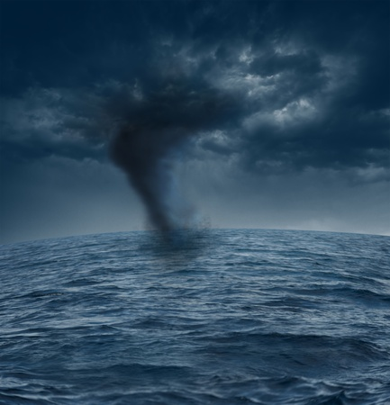 whirlwind: Dark stormy clouds over the ocean