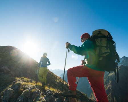 expedition: couple hiking in the mountain  Stock Photo