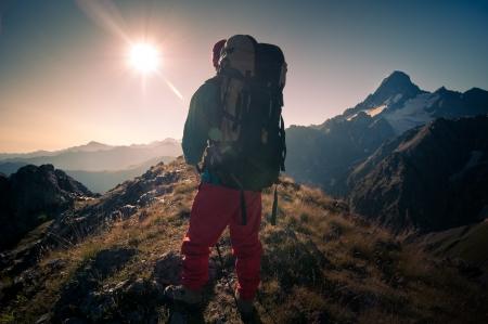 man hiking in a mountain